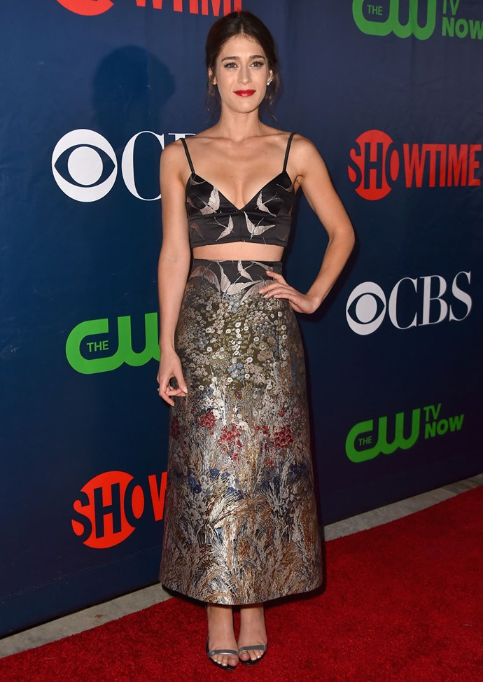 *Masters of Sex* star Lizzy Caplan wears a cropped top and skirt from Valentino at an event for CBS.