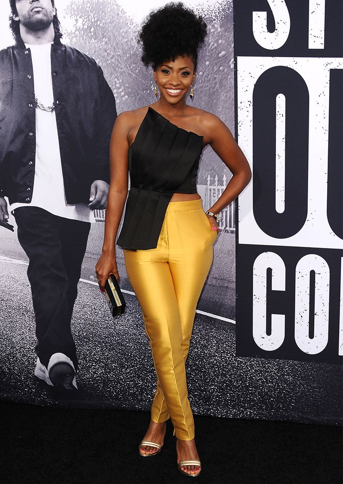 Teyonah Parris wears a top from Keep Sake The Label and pants from John Paul Ataker at the *Straight Outta Compton* premiere