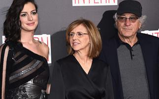 Anne Hathaway's hilarious reaction to Mariah Carey attending The Intern premiere