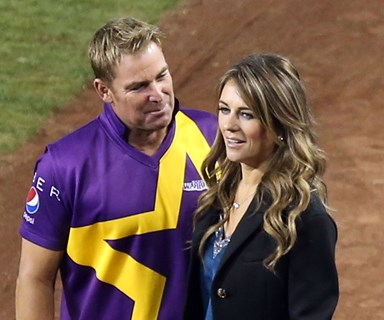One more innings? Exes Liz Hurley and Shane Warne get VERY close