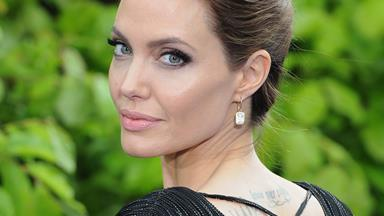 "OUCH! ""I was tattooed by Angelina Jolie's Thai guru!"""