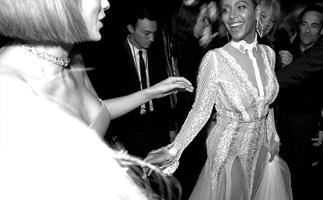 Beyonce and Taylor Swift share a dreamy moment at the 58th Annual Grammy Awards.