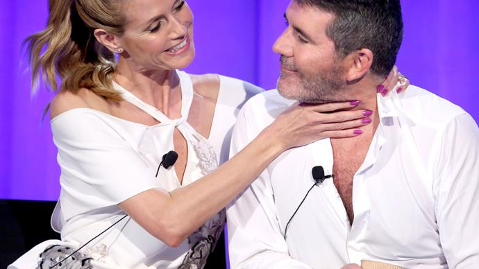 Heidi Klum gets a friendly grip on Simon Cowell