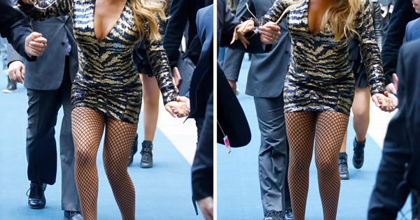 1d2ea8b4616b Mariah Carey trips in sky high heels