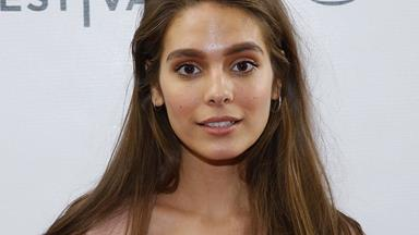 Former Neighbours star Caitlin Stasey embraces her nude body