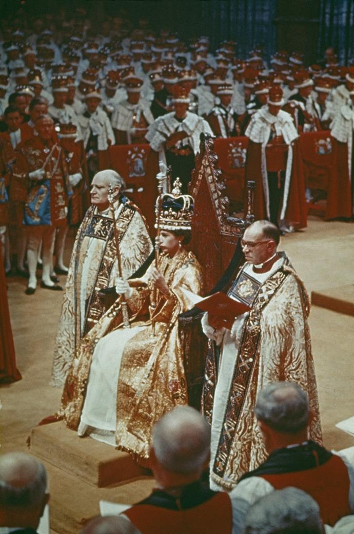Queen Elizabeth II at her coronation ceremony in Westminster Abbey, June 1953. The Queen's coronation gown was embroidered with flora from countries of the Commonwealth - including New Zealand's silver fern. Photo: Hulton Archive via Getty