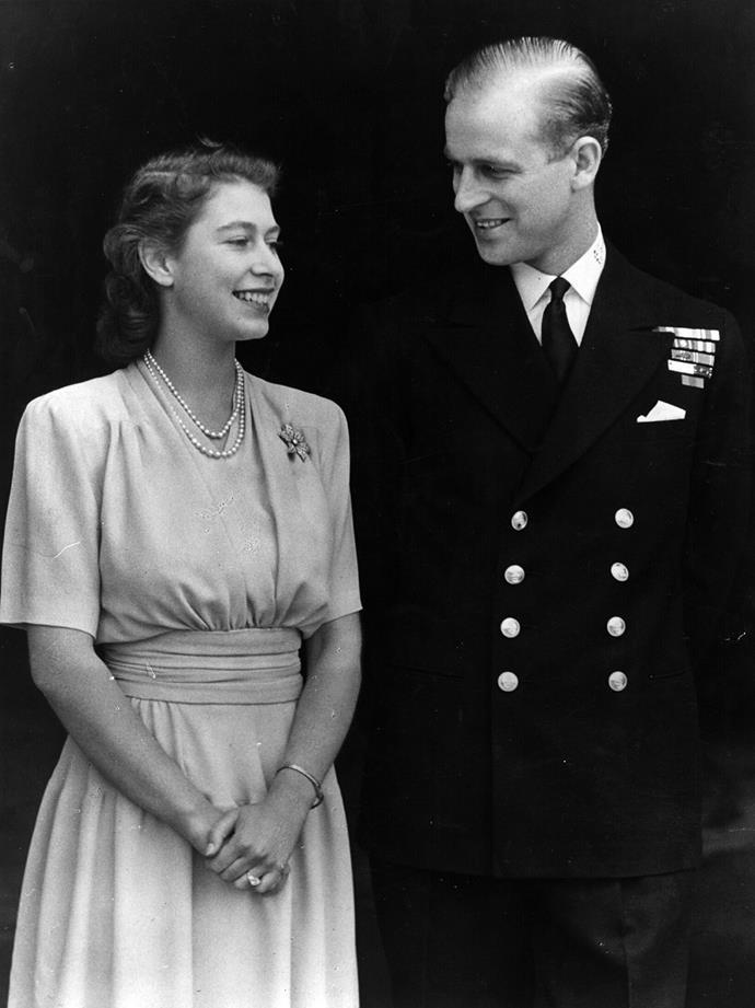 Princess Elizabeth and Philip Mountbatten, Duke of Edinburgh, pose for an engagement photo at Buckingham Palace in 1947. Photo: Fox Photos via Getty
