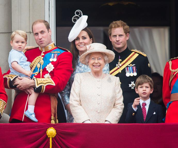 Prince George, held by doting dad Prince William, Duchess Catherine, the Queen, Prince Harry and Prince Philip are pictured on the balcony at Buckingham Palace during the celebrations, which officially mark the sovereign's birthday. Photo: Getty