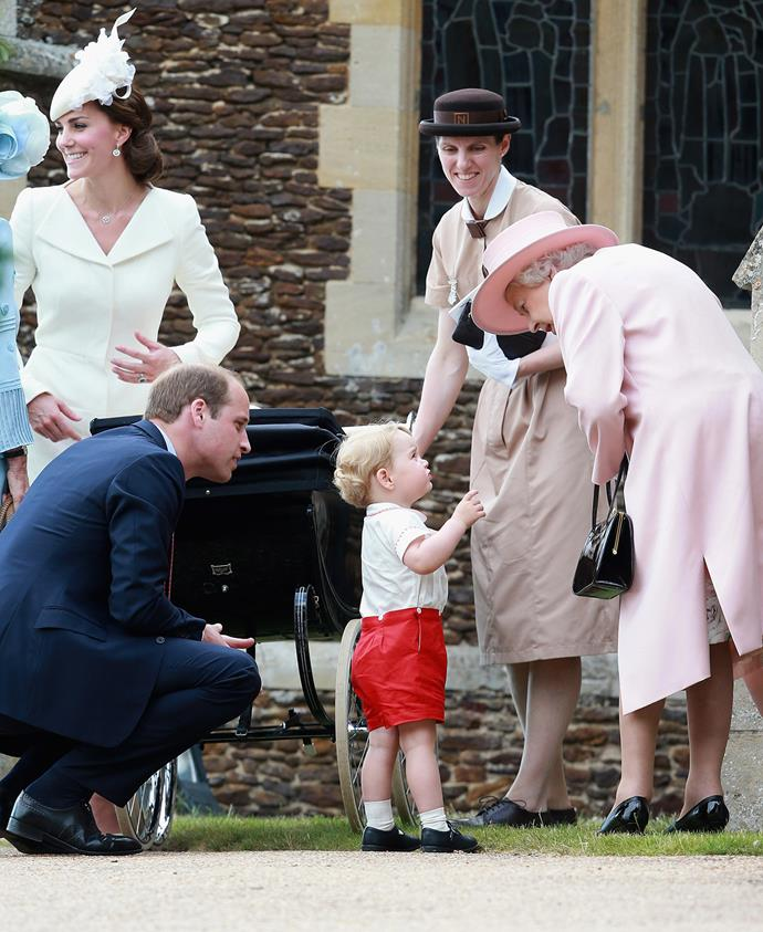 The Queen leans down to talk with her great-grandson Prince George at the christening of Princess Charlotte. Photo: Chris Jackson/Getty