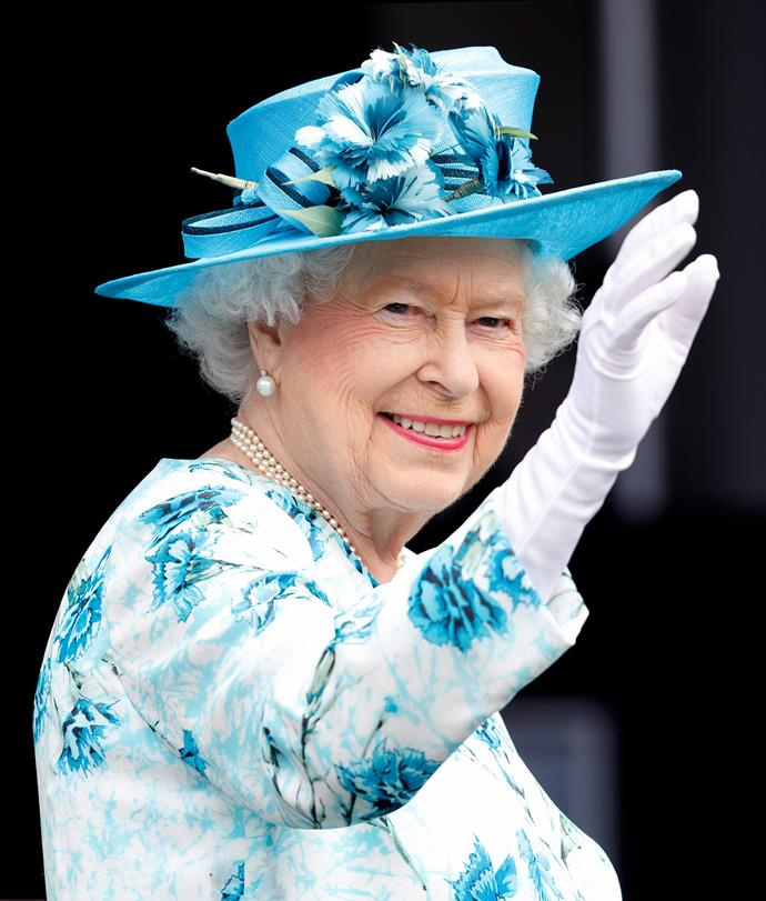 Queen Elizabeth II waves during a visit to the London Borough of Barking and Dagenham on July 16, 2015. Photo: Max Mumby/Indigo via Getty