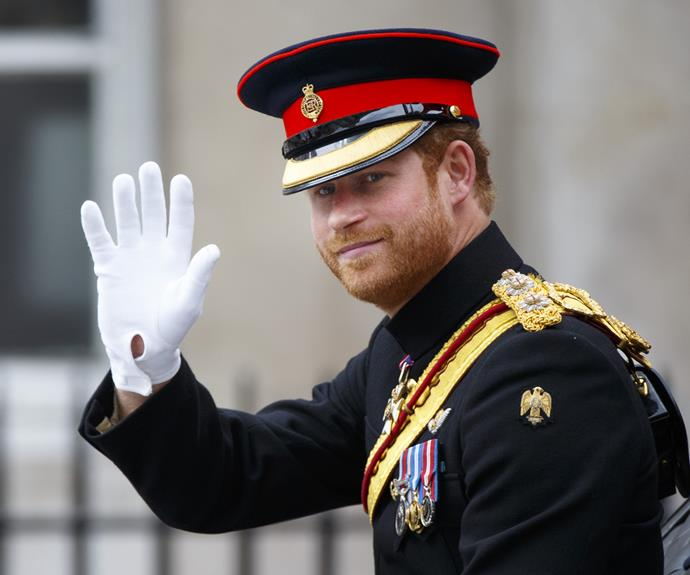 Prince Harry waves to the crowd in London.