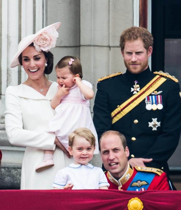 The royals look out to the sea of people.