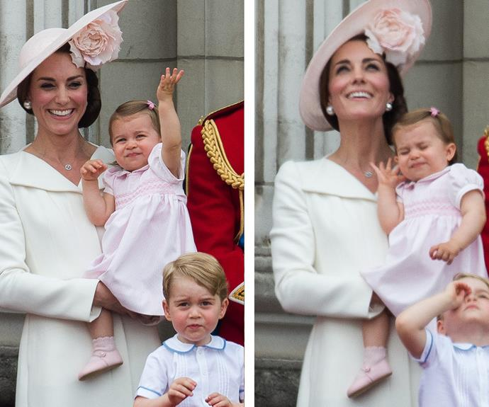 Young Charlotte tried out her royal wave before covering her ears as the loud planes flew overhead of Buckingham Palace.