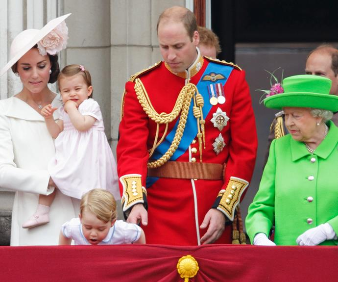 Curious George couldn't help but peek over the balcony! The Queen looked a tad concerned but dad Wills was supervising closely.