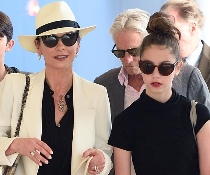 Catherine Zeta-Jones and 13-year-old daughter Carys looked the double of each other as they were spotted at the airport together in London.