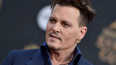 Johnny Depp changes tattoos as a dig at ex Amber Heard
