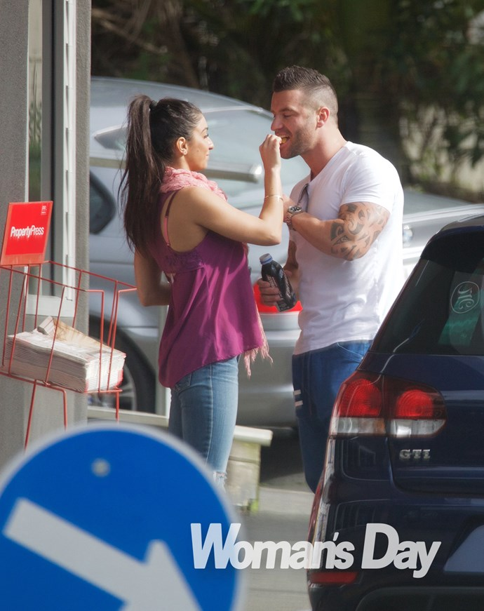 The couple share a snack as they are snapped on a busy Auckland street.