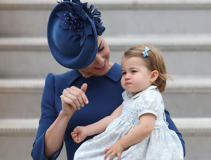 Kate shows her bub how to wave.