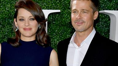 Brad Pitt accompanies Marion Cotillard on red carpet