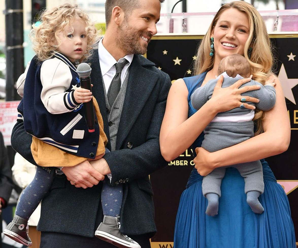 Ryan, pictured with his daughter James, his newborn baby girl and wife Blake, was recently inducted into Hollywood's Walk of Fame.