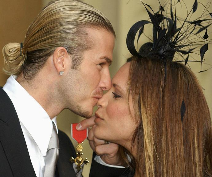 The couple have always been a great support to each other! Here they are in 2003 minutes after David received his own OBE.