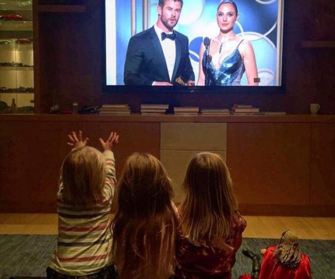 """Absolutely precious! Chris Hemsworth's wife Elsa Pataky took to Instagram to share the adorable moment the couple's three children spotted their dad on TV at the Golden Globes. Sitting next to a *Thor* doll made in the likeness of their """"papa"""", one of the little boys even reached out for a hug."""