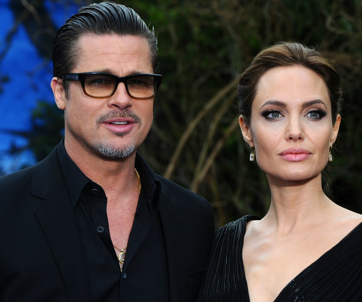 The actor, pictured with his soon-to-be ex-wife Angelina Jolie, cut a trim figure at this week's Golden Globes.