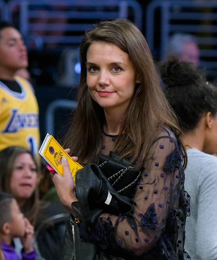 Katie kept things understated but chic at the sports game.