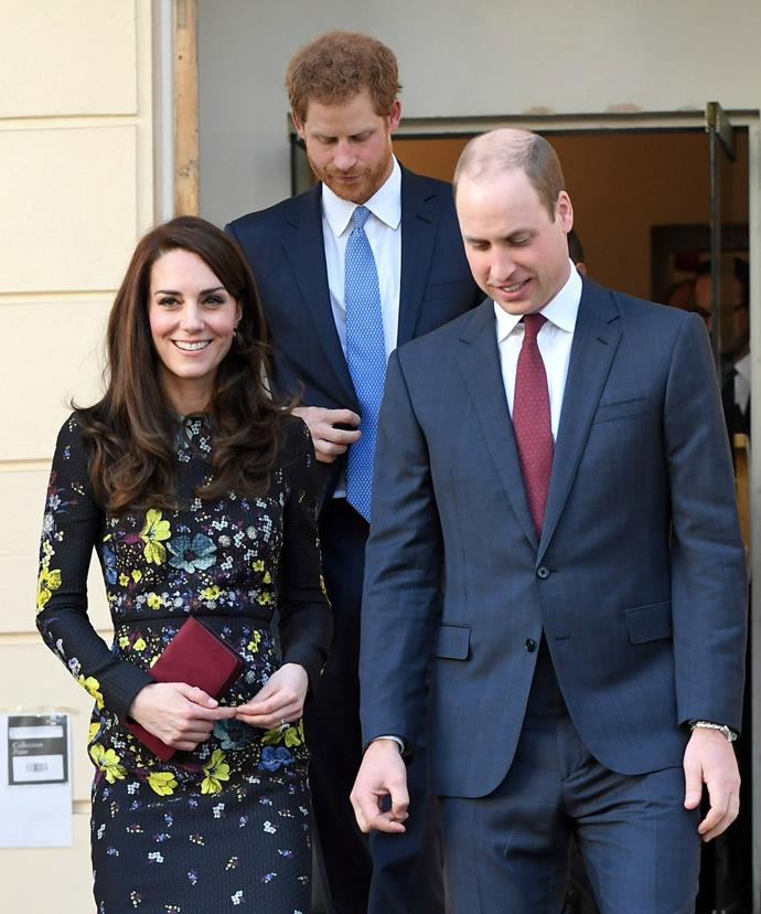 Coincidence? Has Kate matched her wine-coloured clutch to her hubby's tie?