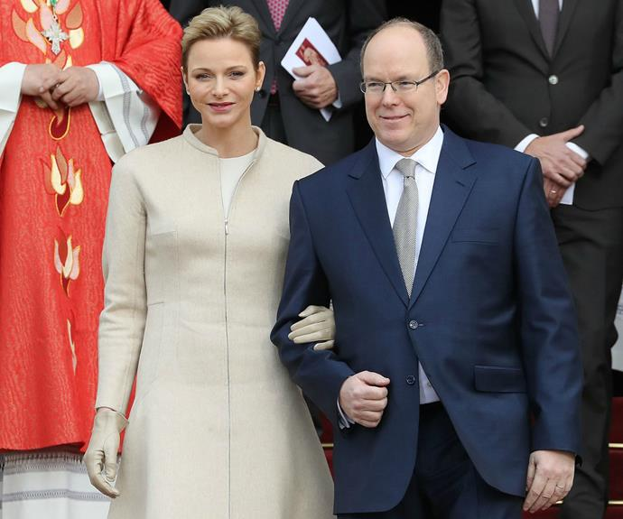 Prince Albert, joined by his wife Princess Charlene, attend mass earlier in the day.