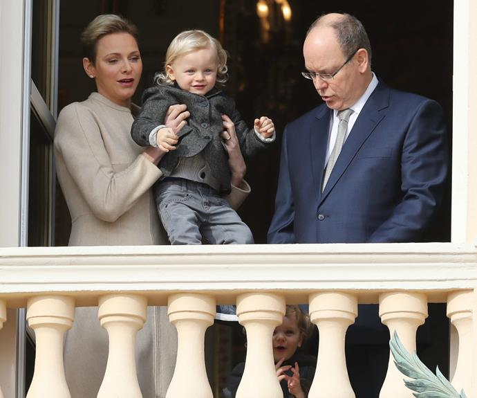 Princess Charlene lifted Jacques up so he could see the crowd.
