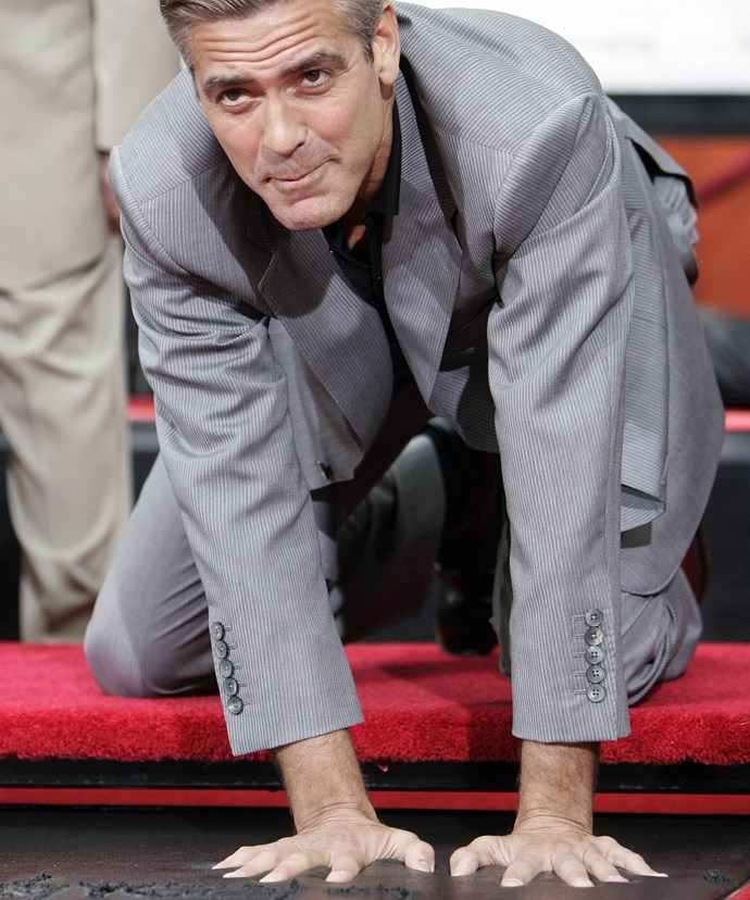 George Clooney immortalises his prints in cement in the famed forecourt of Grauman's Chinese Theatre, in celebration of the film Ocean's Thirteen.