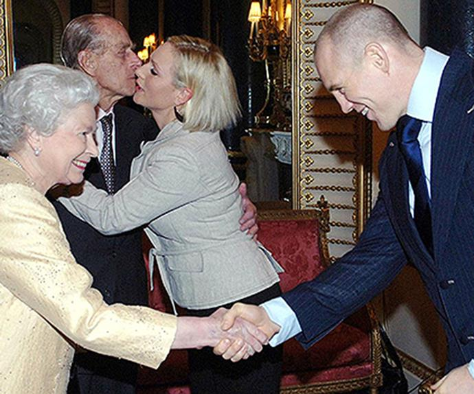 Mike greeting his wife Zara's grandparents, the Queen and Prince Philip.