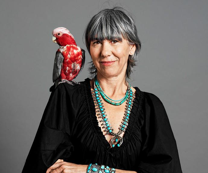 """Sheridan Davey, 55, with her galah, Graham, 14. """"I must have gone grey when I was 45. My hair was really dark brown and I did colour it for a while, but then I thought, """"I can't do this anymore""""."""