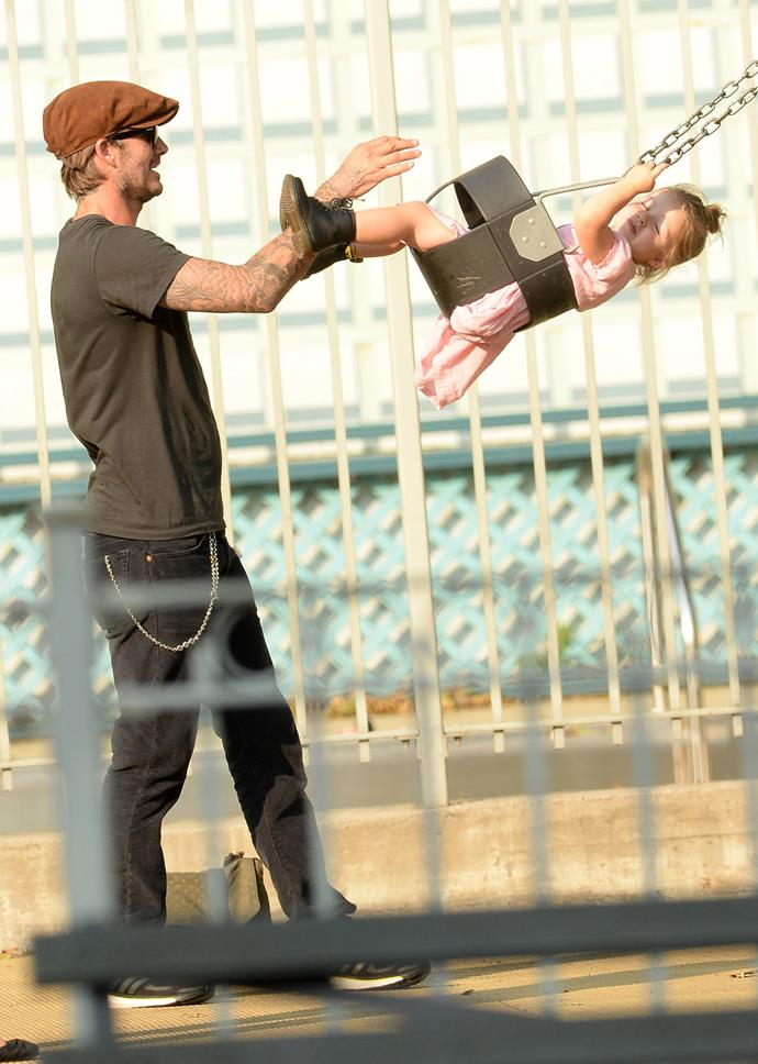 David pushing Harper on the swing while on holiday in America.