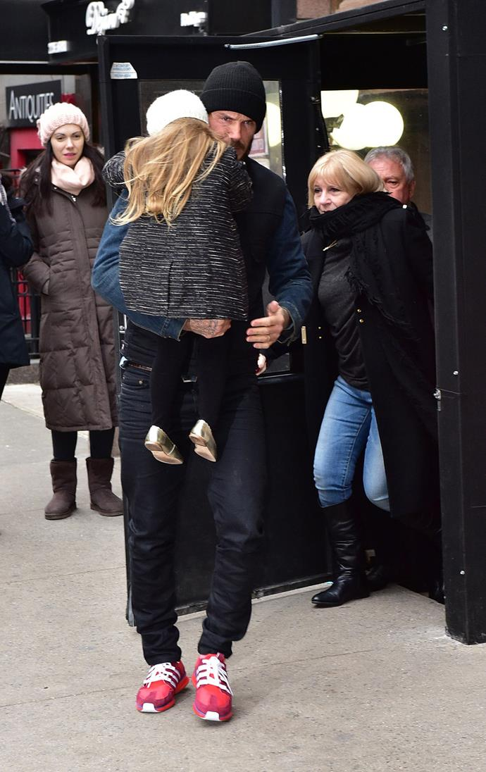 David carries Harper in the New York chill.