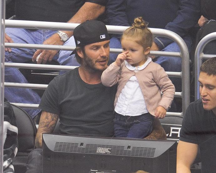Introducing sports early: David takes Harper to a Hockey game in LA.