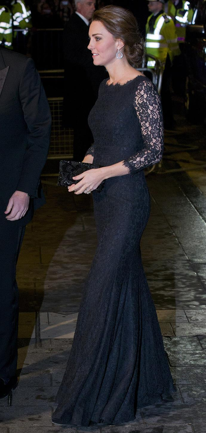 She was wearing black again for her next engagement at the Royal Variety Performance, this dark Diane Von Furstenberg gown featured lace sleeves with a scalloped neckline. She wore diamonds and a black clutch with the look.