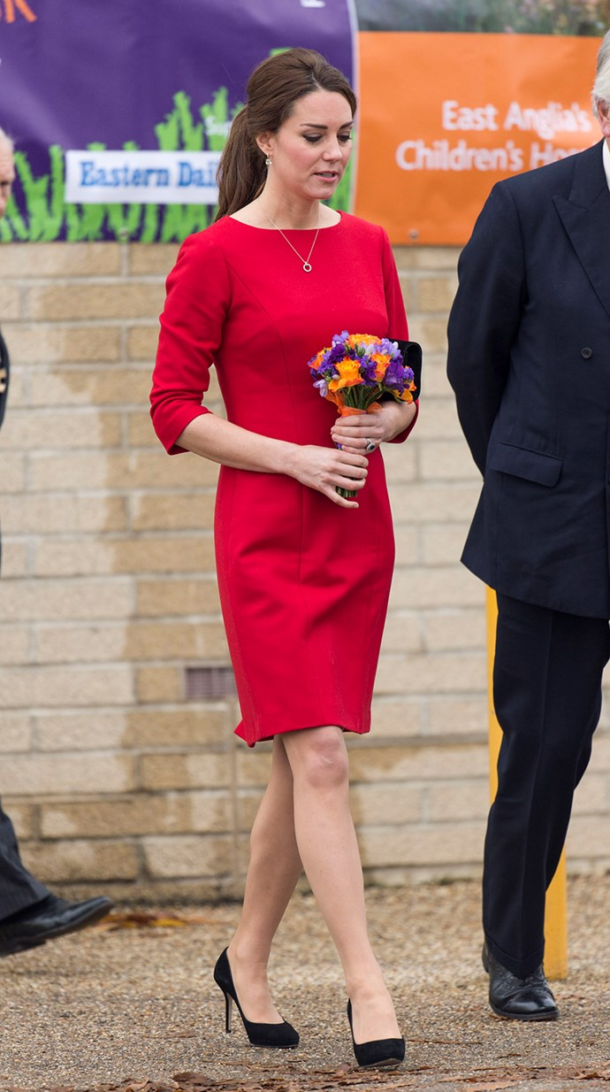 Braving the cold weather and debuting a bit of colour, the pregnant Duchess wore a bright red Katherine Hooker long-sleeved dress with green jewels, black pumps and a ponytail.