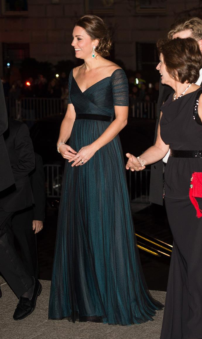 Stepping out in another dark colour, Duchess Kate decided to wear this dark green Jenny Packham for the third time. She mixed it up with emerald jewels and an up do.
