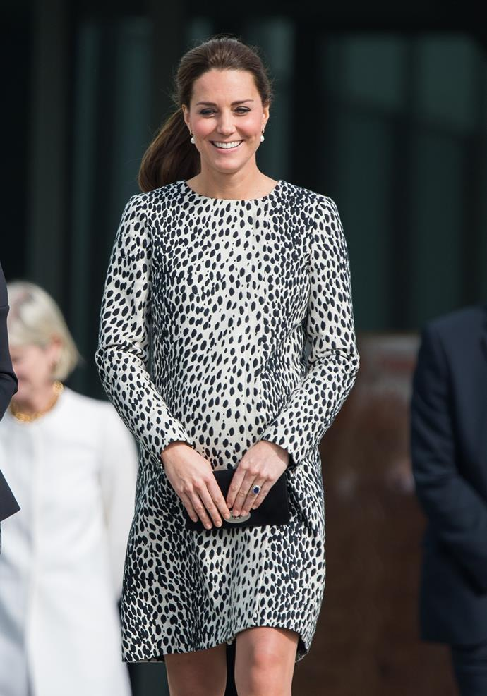 For her visit to the Turner Contemporary Gallery, Kate chose to recycle this Dalmatian print shift she wore while pregnant with George. She paired the look with black pumps, a black clutch and a sleek ponytail.