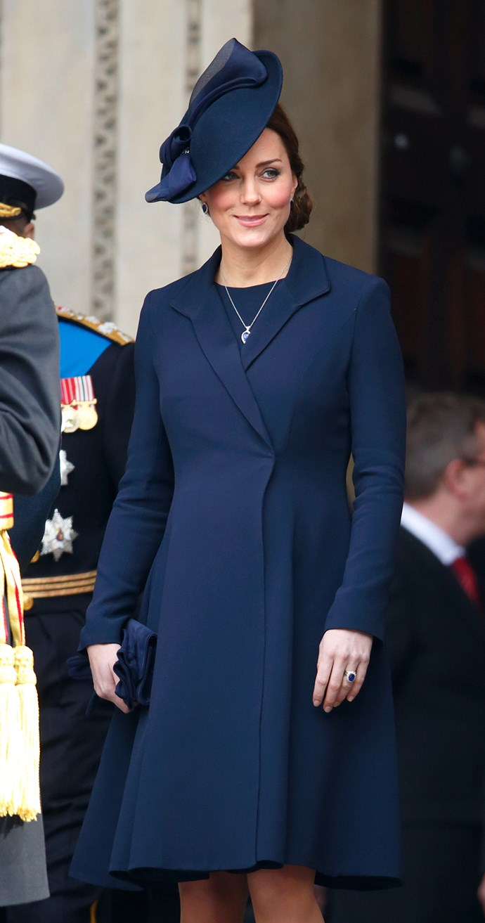 Blue seemed to be the order of the day for the Duchess. She wore this stunning Beulah London maternity coat in navy blue, with a navy dress, navy pumps, navy hat, a navy pendant and her engagement ring, which happens to be – you guessed it – navy blue.