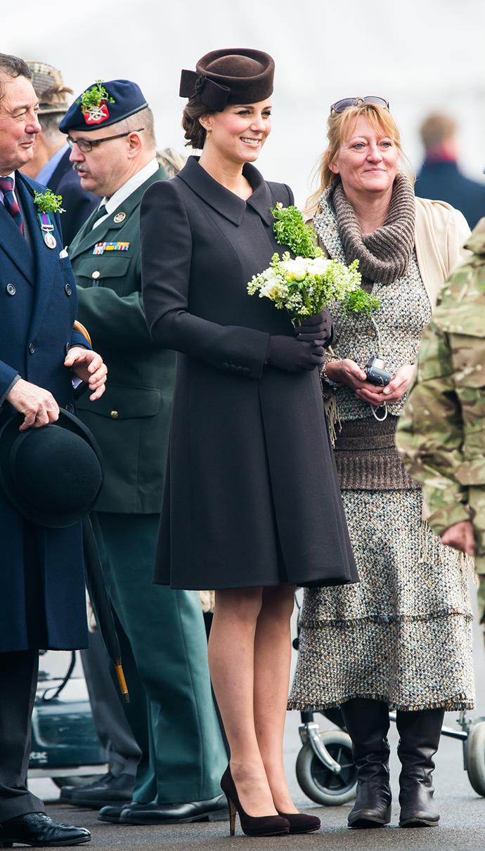Forgoing the typical green dress, Kate attended the St Patrick's Day celebrations wearing this deep brown Catherine Walker dress, with a pill box hat of the same colour. She accessorised with brown pumps, a sprig of fresh shamrocks, and a diamond shamrock broach loaned to her by the Queen Mother's collection.