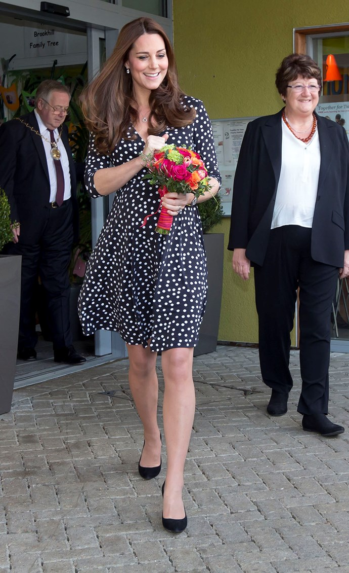 "Showing off just how strong the ""Kate Middleton Effect"" really is, the blooming Duchess wore this spotted ASOS Maternity dress, only for it to sell out in less than 3 minutes."