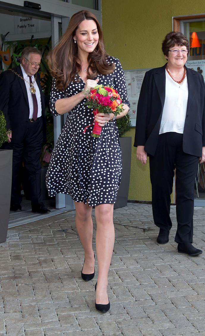 """Showing off just how strong the """"Kate Middleton Effect"""" really is, the blooming Duchess wore this spotted ASOS Maternity dress, only for it to sell out in less than 3 minutes."""