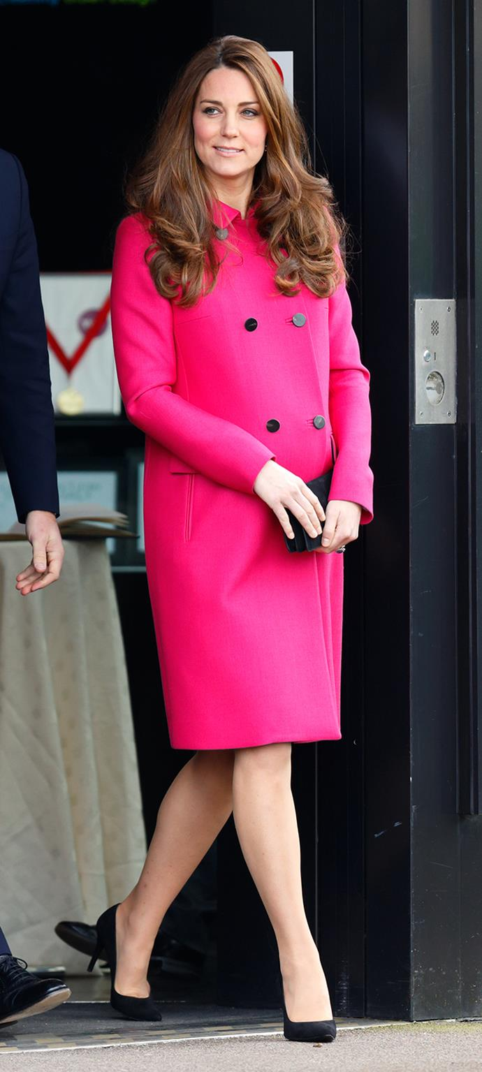 For the Duchess' final appearance before her maternity leave, Kate chose this bright pink fuchsia coat by Mulberry, maybe indicating that she was having a Princess. She paired the coat with black pumps, a black clutch, and beautiful loose curls.