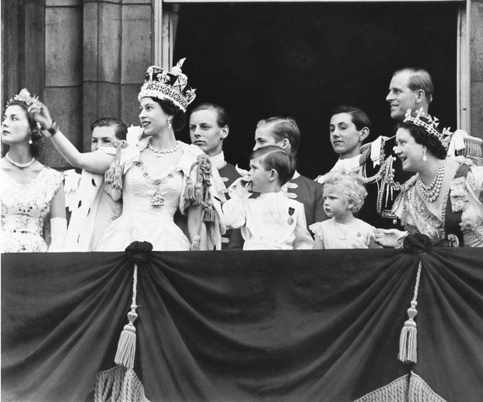 Queen Elizabeth II with her family on the Buckingham Palace balcony after her coronation. *(Image: Getty)*