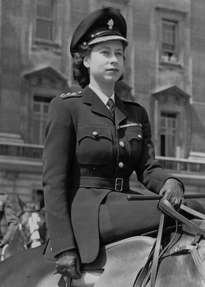 The Princess Elizabeth was also a member of the British Armed Forces. She is seen here leading the troops in a ceremony.