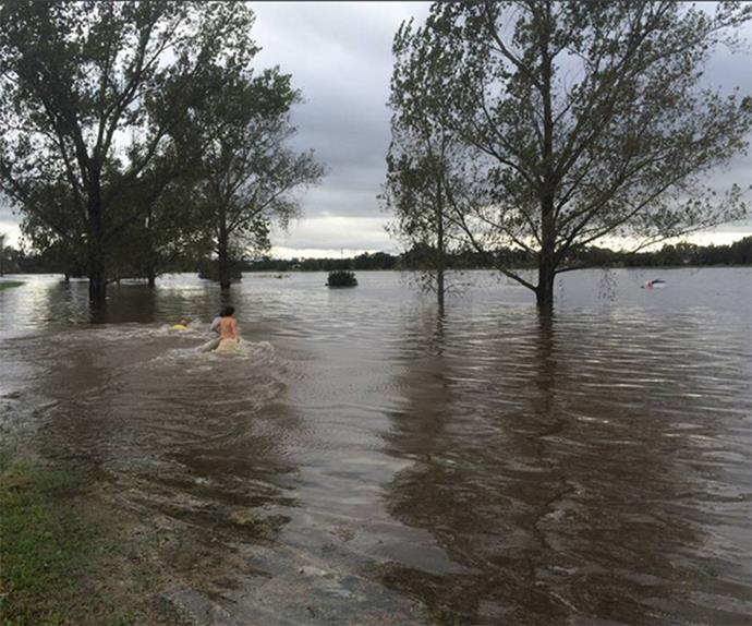 Residents wade into the flood waters to help. via @newcastleherald