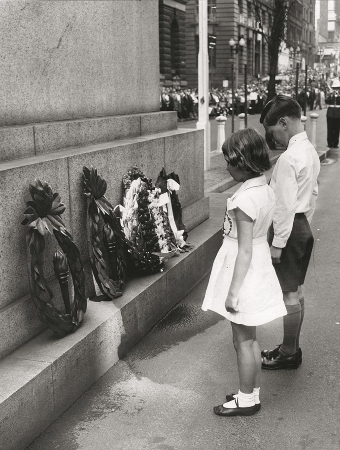 A young girl and a young boy visit the memorial.